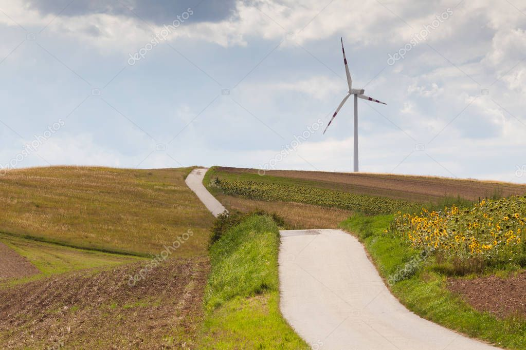 beautiful landscape with wind turbine