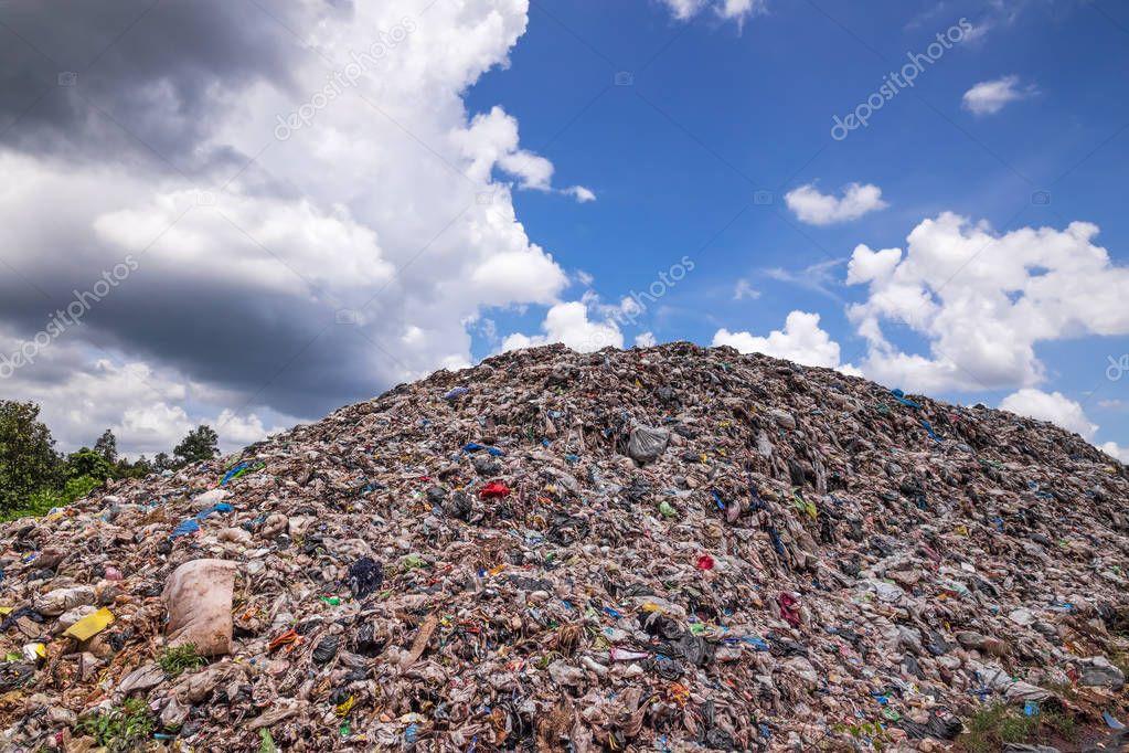 Garbage Dump With Cumulus Clouds
