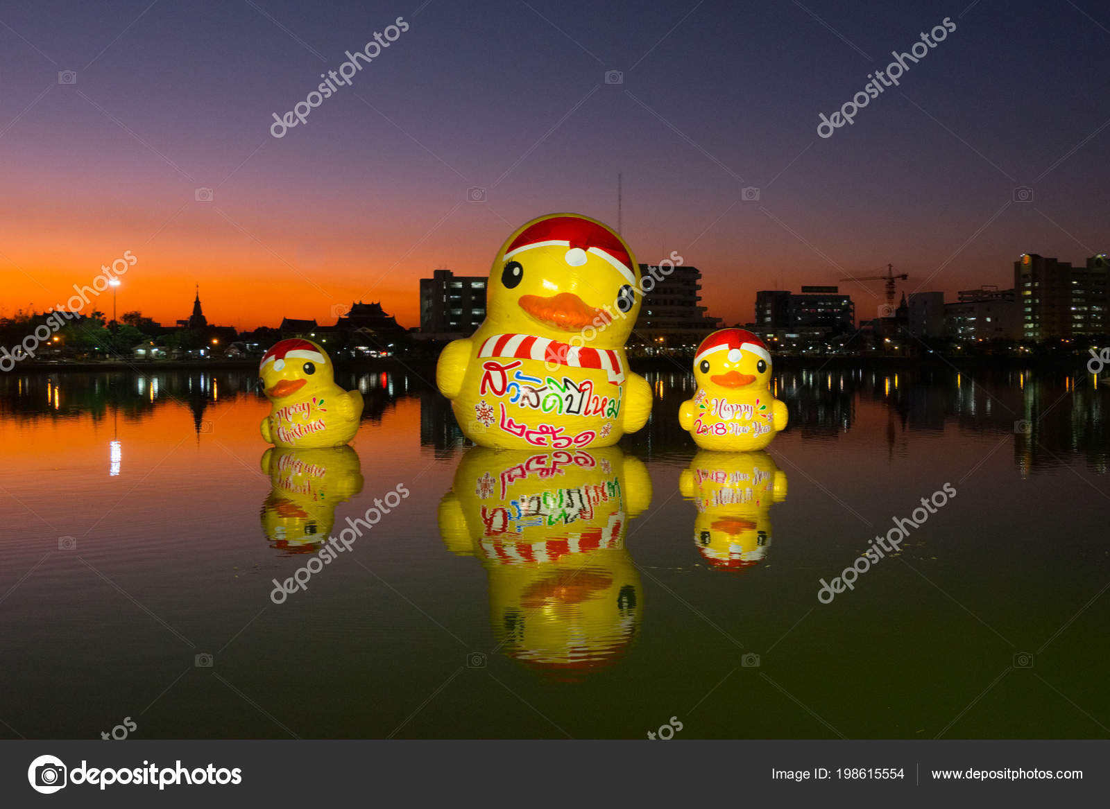 giant rubber duck happy new year thai language chest floating stock photo
