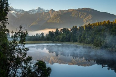 Lake Matheson. Locate near the Fox Glacier in West Coast of South Island of New Zealand. It is famous for its reflected views of Aoraki/Mount Cook and Mount Tasman.