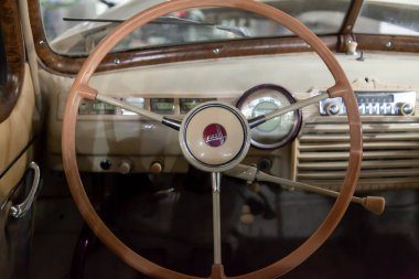 Novosibirsk, Russia - 01.30.19: View from rear seat on the steering wheel and the interior of the old Russian car of the executive class released in the Soviet Union beige GAZ m-20 pobeda