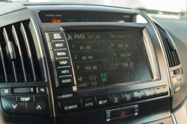 View to the interior of Toyota Land Cruiser 200 with dashboard,
