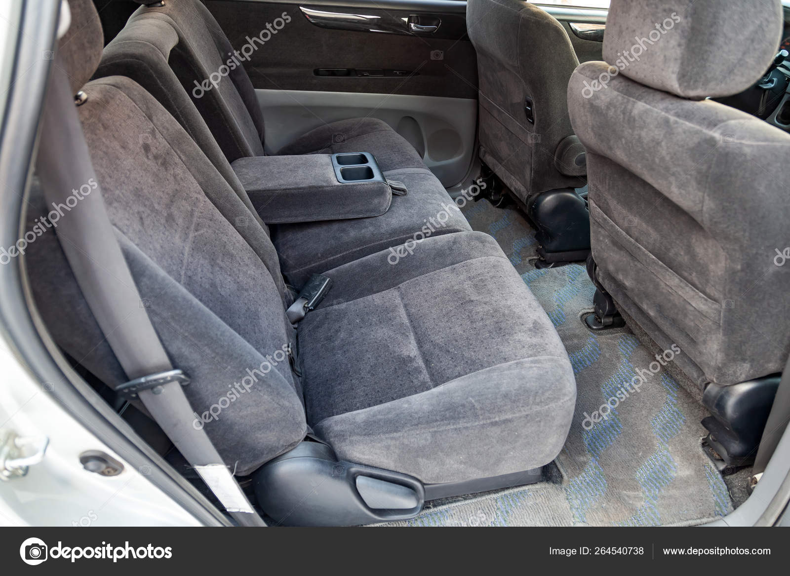 Close-up on rear seats with velours fabric upholstery in the