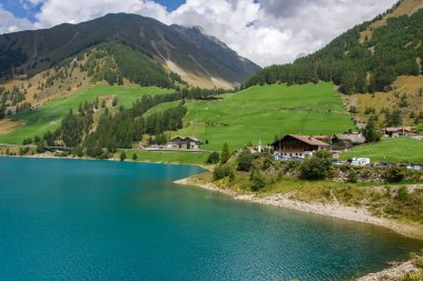 In the alpine valley of Schanlstal, South Tyrol, the colorful lake of Vernago