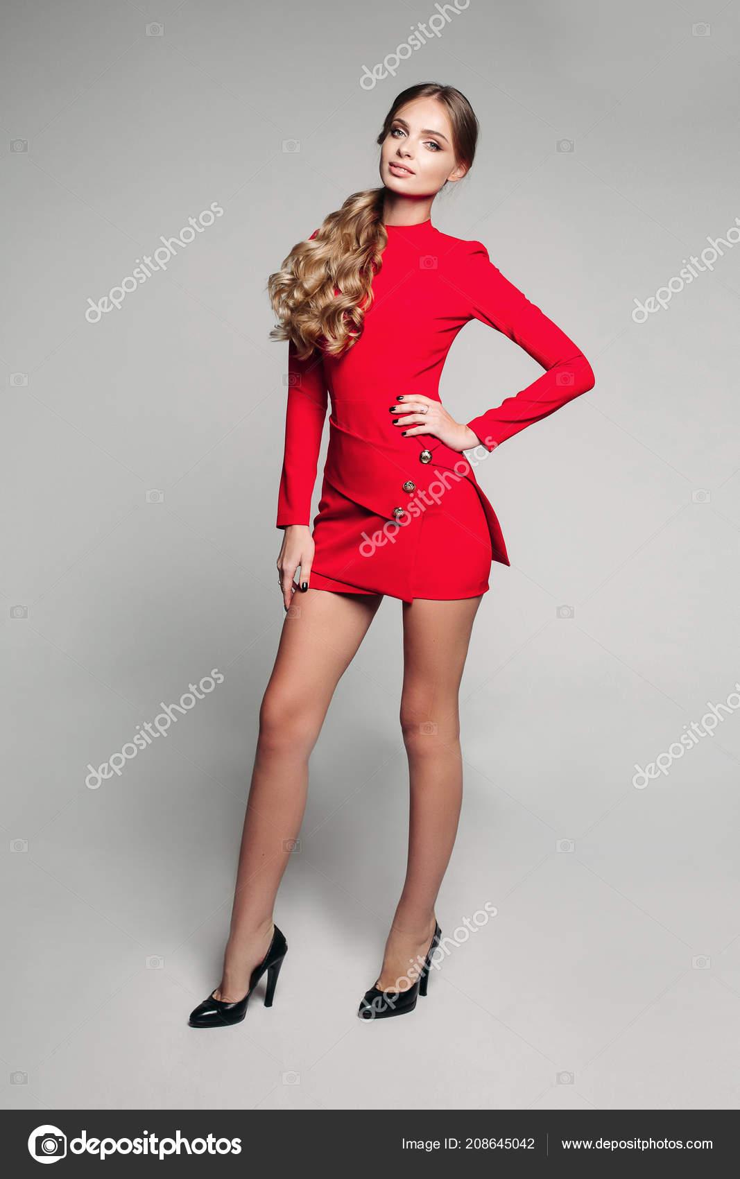 Stunning slim model in bright red dress
