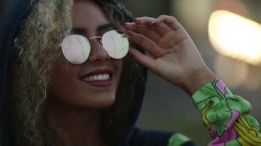 17266a1d2507 Hipster girl wearing in hoodie and sunglasses relaxing and smiling. Stock  Footage