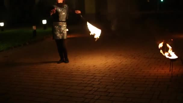 Activity couple dancing and showing with fire at night time.