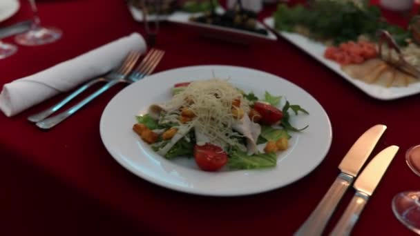 Motion and selective focus of food and drinks on dinner in luxury restaurant.