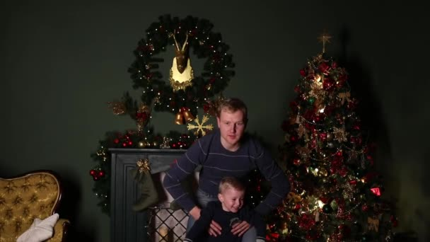 Dad playing with his son at Christmas.