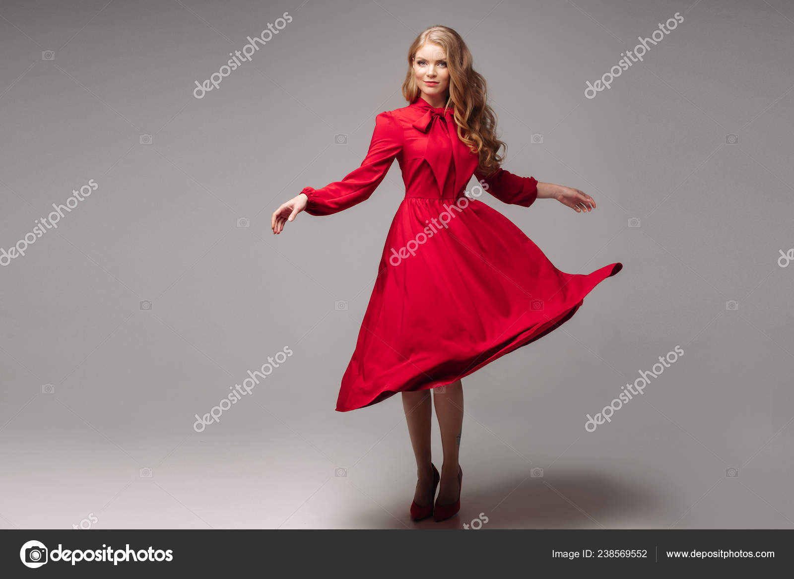 6f459519c87 Stunning slim model in bright red dress and black heels. — Stock Photo