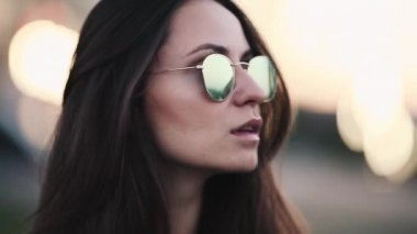 28081db42e30 Beautiful brunette hipster girl with long hair in mirrored sunglasses. Stock  Video