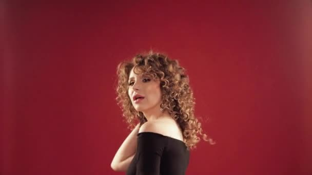 Woman with curly hair dancing and enjoying music