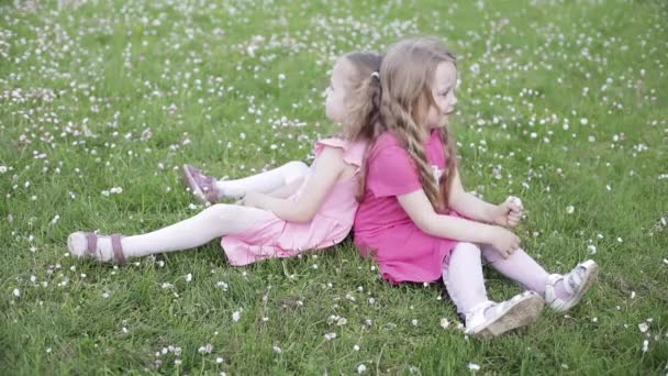 Two lovely little girls in pink smiling at camera.