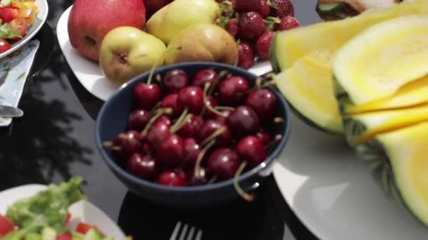 Melon, cherries, strawberries, apples, peaches and sandwich