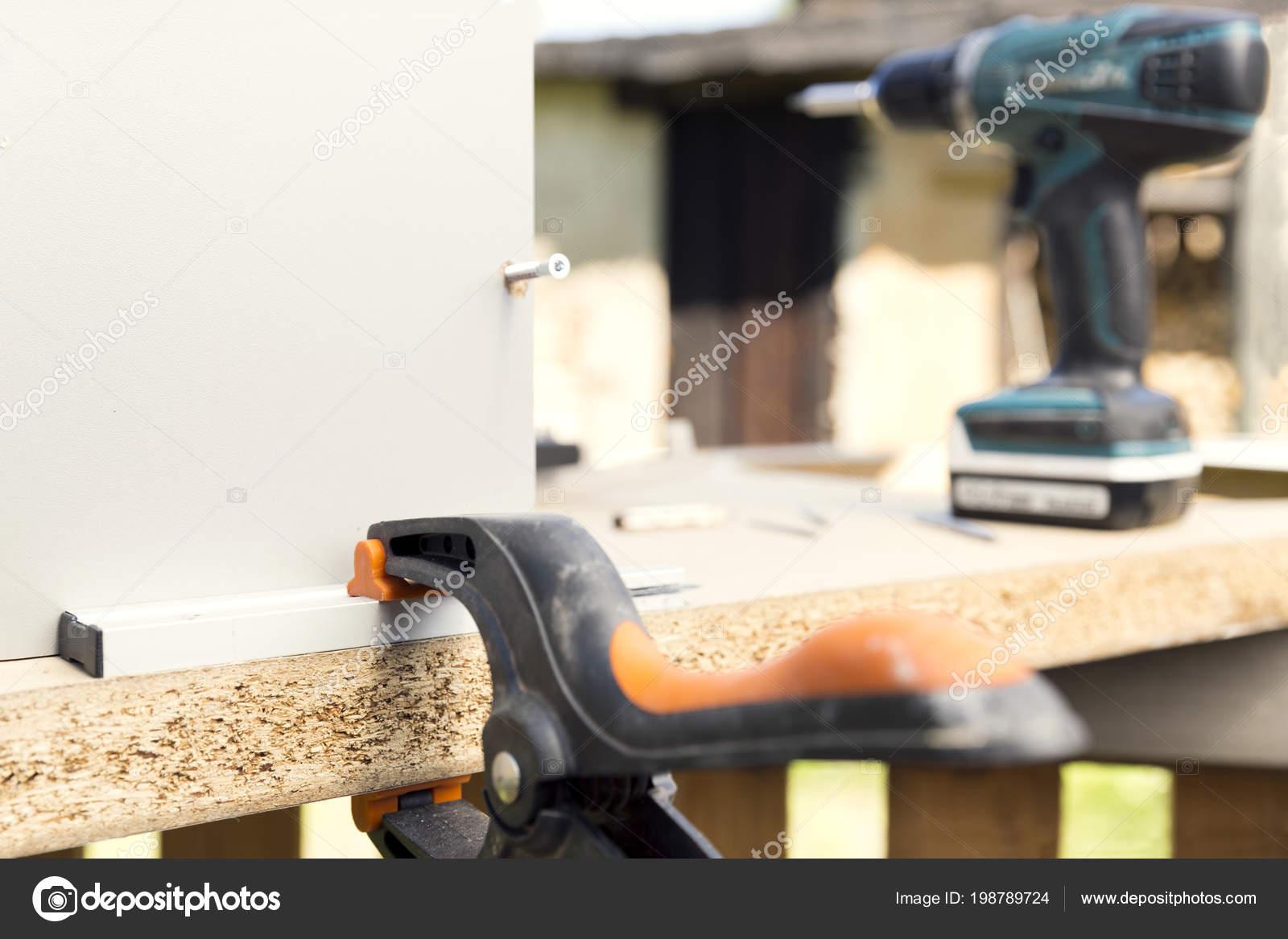 Furniture Assembly Making Kitchen Cabinet Using Screwdriver