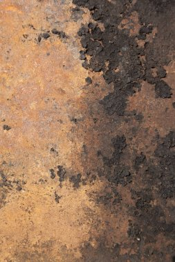The texture of black on a orange surface.