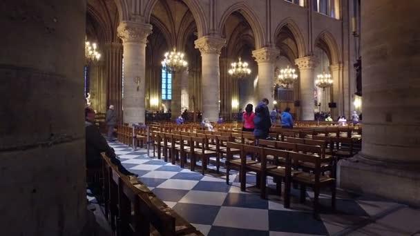 FRANCE, PARIS - circa JUNE, 2017: Tourists visiting Notre Dame de Paris