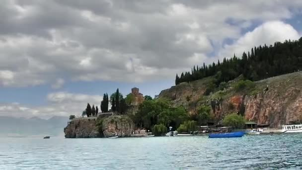 time lapse of view from cruising boat of lake Ohrid and St Kaneo Church on cliff