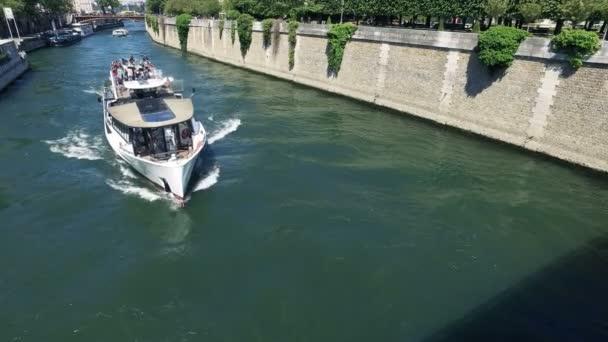 France, Paris - August 15, 2017: Notre Dame with tourist boat tour on Seine, France