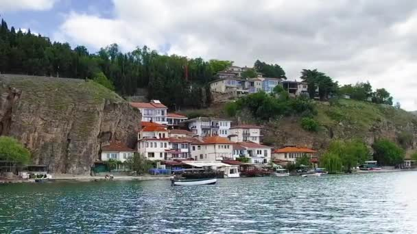 seaside view of Ohrid town from lake, famous unesco historical center separating Macedonia from Albania