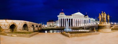Night panorama of Skopje with Archaeological museum, Stone Bridge and statue monument
