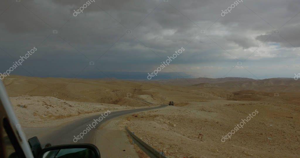 Drive POV on rural road in desert in Israel