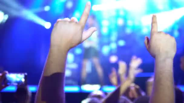 Fans Applauding To Music Band for Live Performing a Concert on Stage in Open Arena, Selective Focus. Public concert, no ticketing event