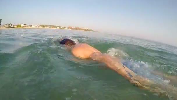 Sport man marathon swimmer swimming front crawl, folowing shot