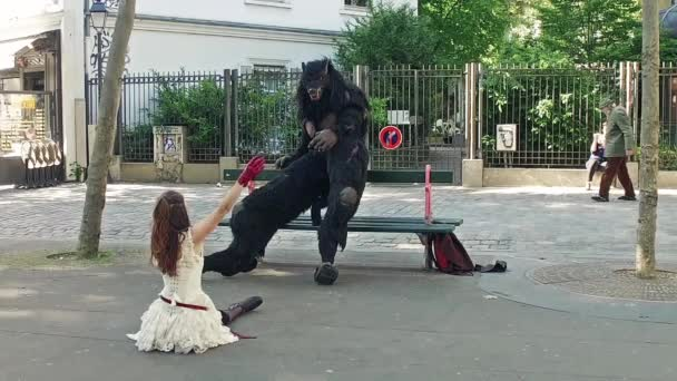 Couple doing some balet performance moves in front a street crowd at Monmartre in Paris. Its popular form of earnings in big cities. Beauty and beast in Slow Motion