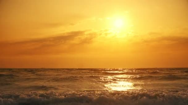 Rough waves with view of sunset at tropic sea