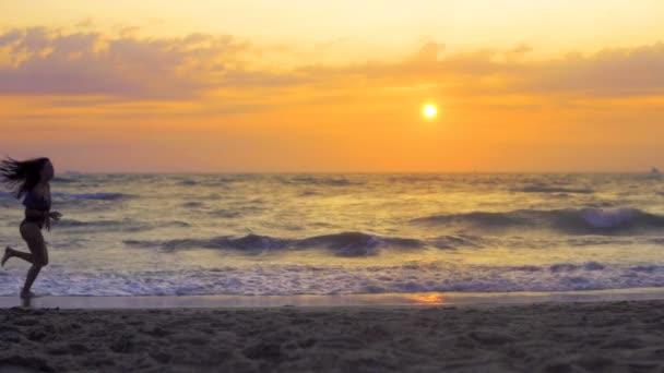 Three children running, jogging on summer beach sunset, SLOW MOTION