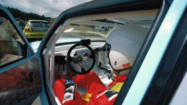 Kocani, Macedonia - 24 Jun, 2018: Hill climbing race car driver shifting and steering. View from inside