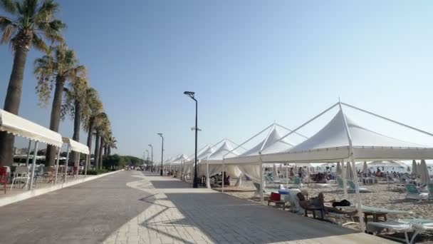Touris walk pov on promenade seafront, beach,coast of beach resort in Durres, Golem, Albania