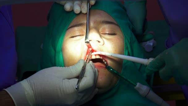 Dental implant surgery, apicectomia gum operation, closeup