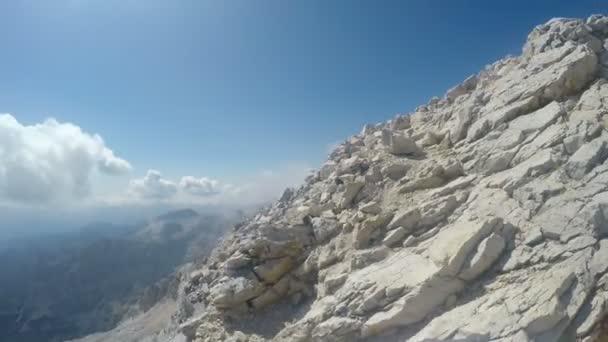 Mountaineer pov to expedition climbing to rocky mountain summit Triglav on Julian Alps mountain range