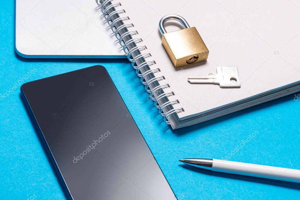 Smart phone with padlock and key, data protection concept