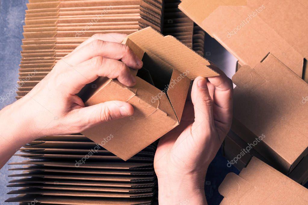 Man preparing carton boxes