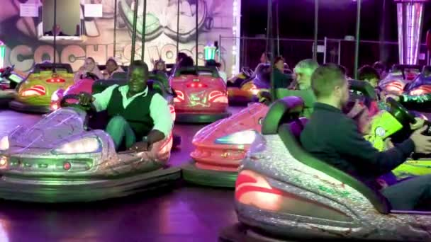 Tenerife, Spain - March 9, 2019: People enjoying bumper cars during Tenerife carnival, Canary islands, Spain.