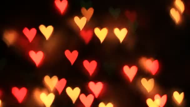 Animated Highlights in the shape of a heart. This seamless loop can be used as a background layer.