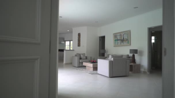 European-style living room with white walls, gray lounge furniture, great big house with elegant furnishings