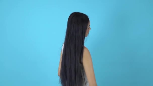 Portrait of young model with loosen long hair, asian girl poses on background