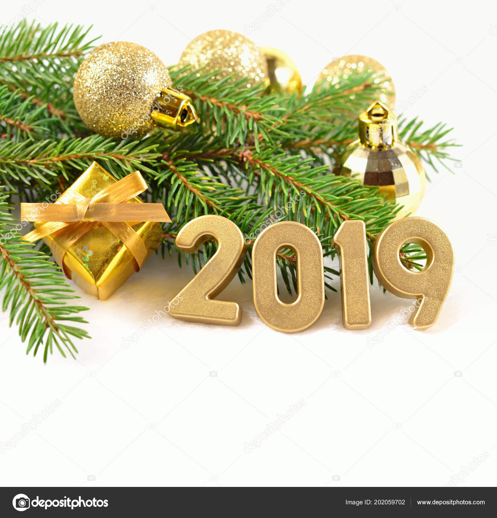 2019 Year Golden Figures And Spruce Branch And Christmas Decorations