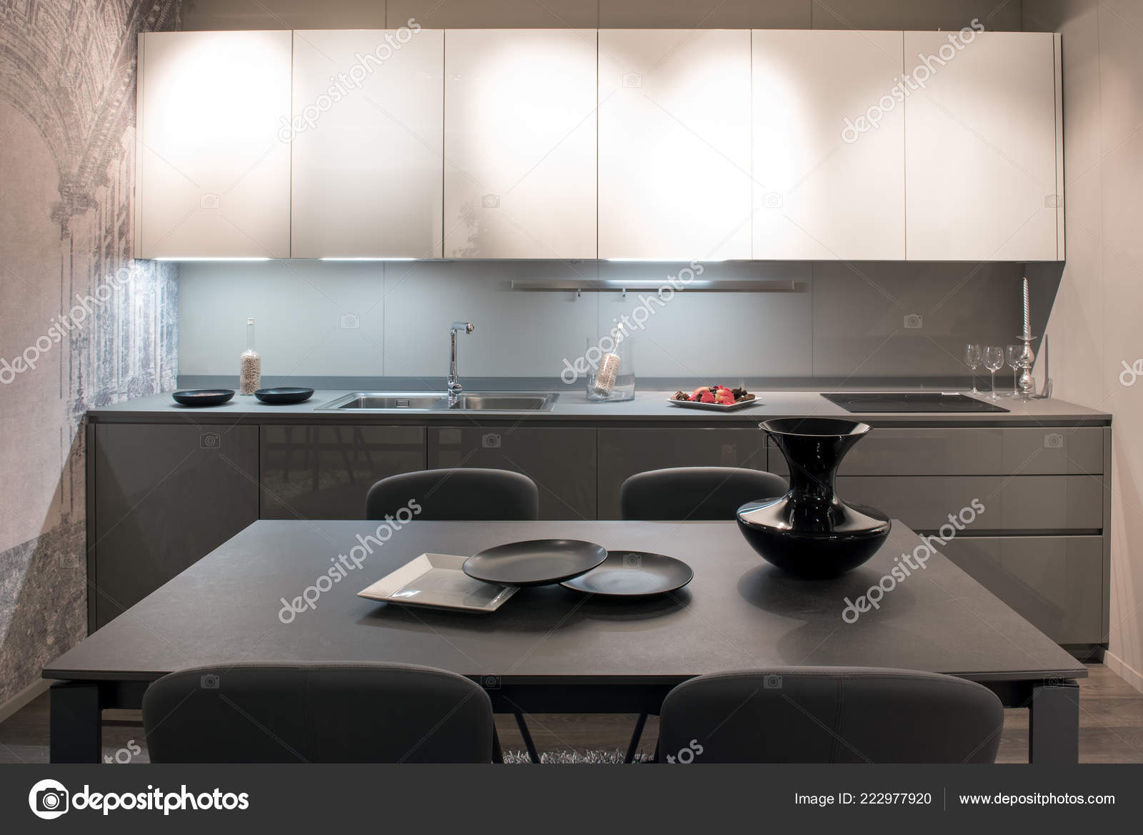 Compact Modern Grey And White Fitted Kitchen With Illuminated Cabinets A Dining Table Set Ceramics Stock Image