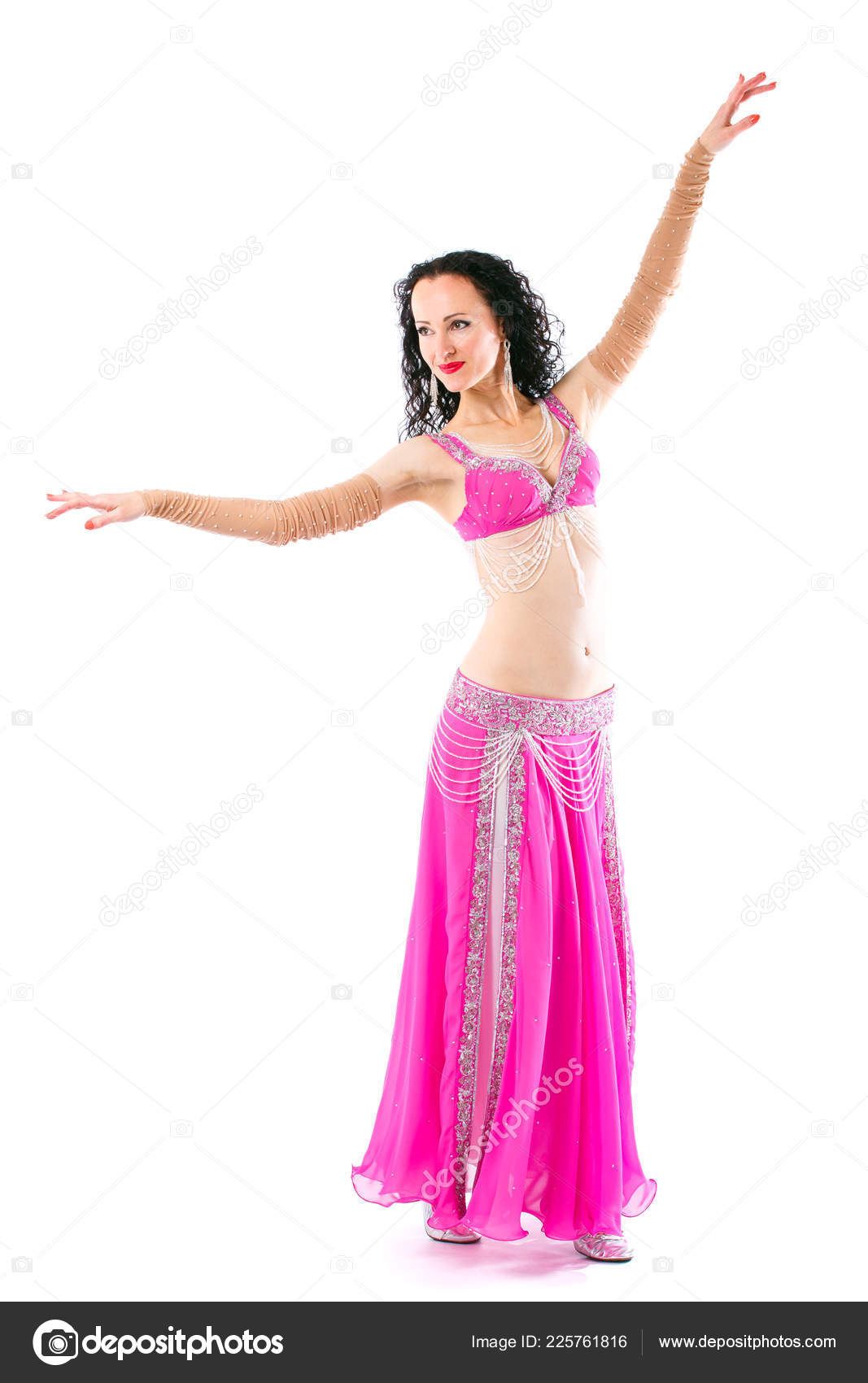 a48a5e7162f0 Wonderful brunette in the pink dress of an oriental dancer. Professional  shooting of a young beautiful girl in the costume of an oriental dancer.