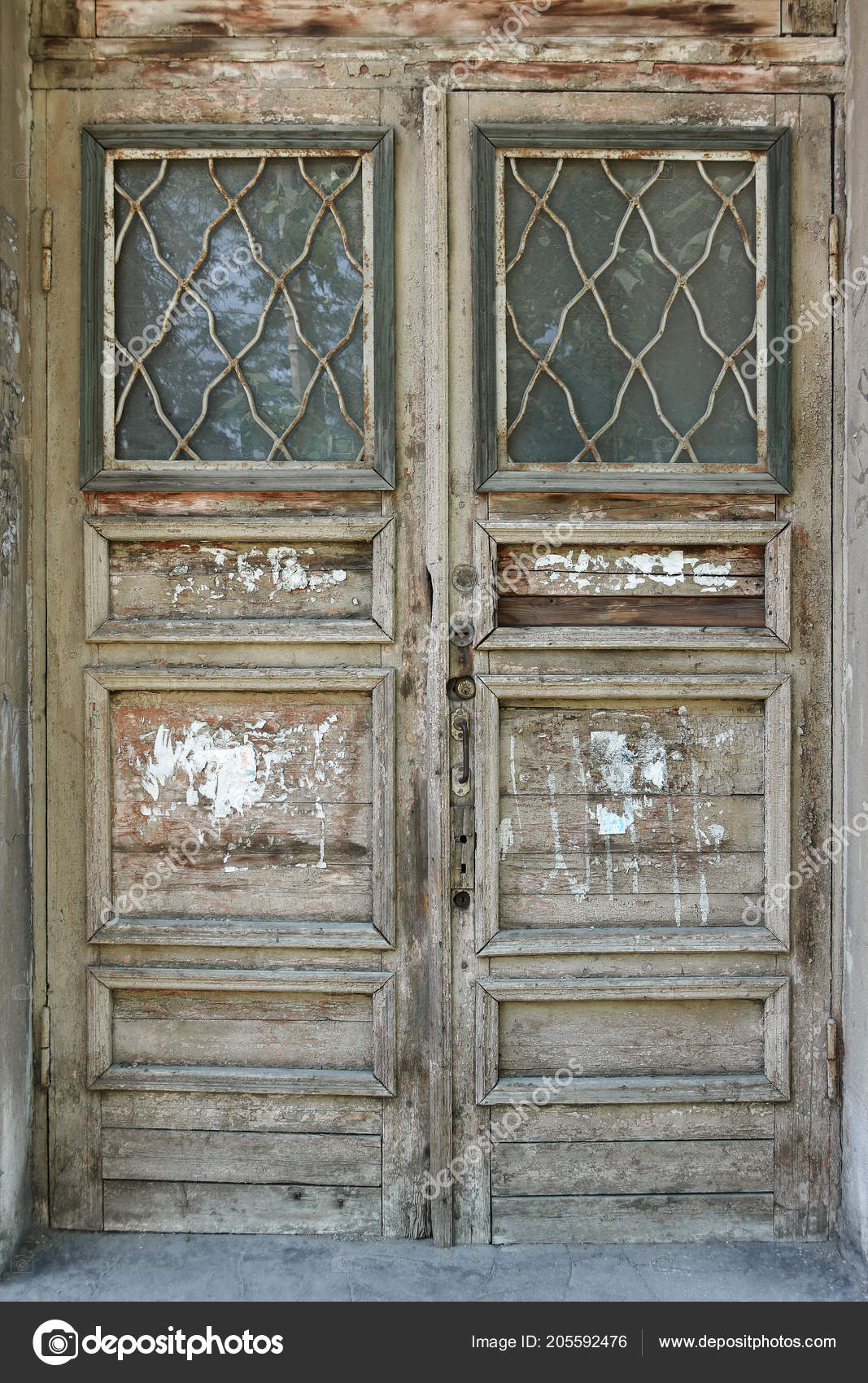 Old Wooden Vintage Door In The Door Frame Stock Photo