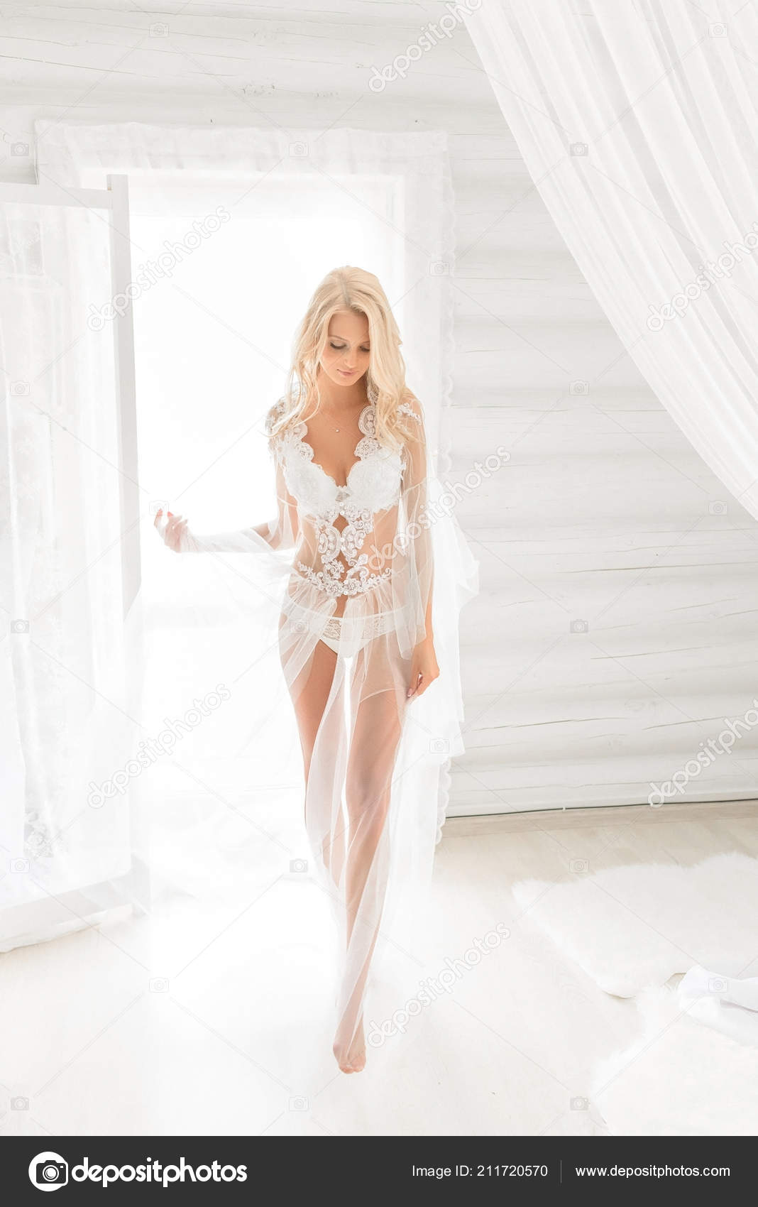 413f9b522 Wedding morning of a beautiful bride walking in a lighted room with only white  lace underwear on. Beautiful blonde — Photo by ...