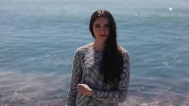 Half-length portrait of a beautiful girl in front of the sea