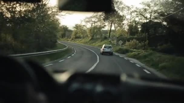 Barcelona, Spain - April 28, 2018: Driving along a country road at sunset