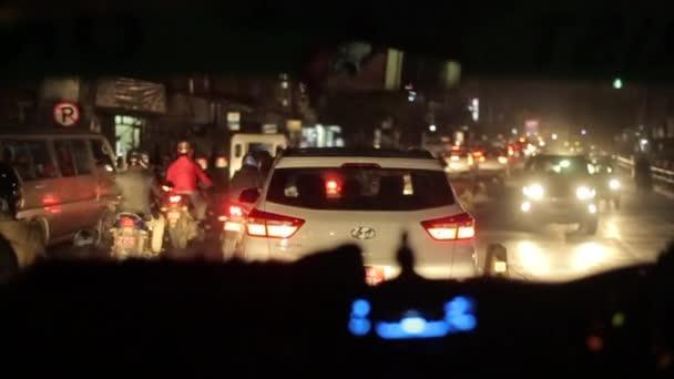 Kathmandu, Nepal - 14 November 2019: View from a car stuck in traffic jam at night at a nepalese busy road. Night time. Asian streets. Kathmandu, Nepal.