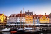 COPENHAGEN, DENMARK - MAY 6, 2018: scenic view of beautiful colorful buildings and boats moored in harbor, copenhagen, denmark